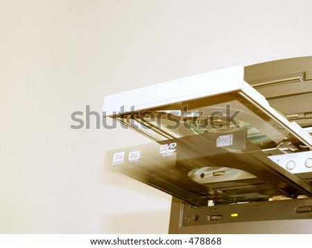 cd/dvd drive opening with motion blur - stock photo