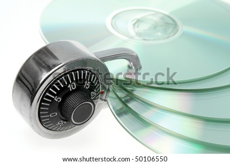CD/DVD safely backed up by padlock. - stock photo