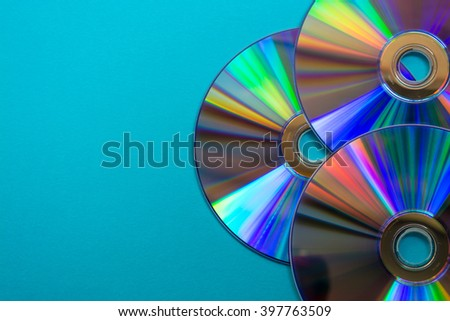 Cd on blue background - stock photo