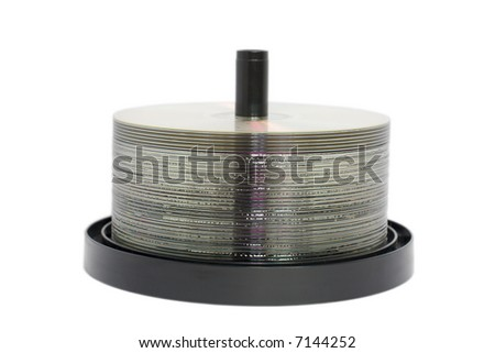 CD or DVD discs on a spindle.  Isolated on a white background. - stock photo