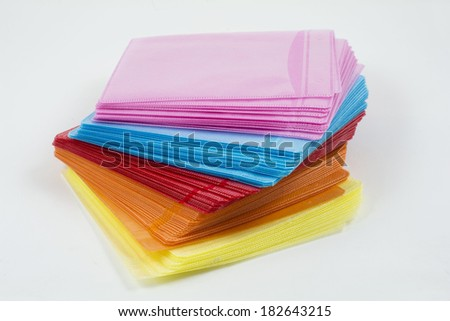 CD or DVD in colored plastic cases isolated on white - stock photo
