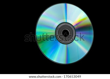 CD or DVD isolated on black background.
