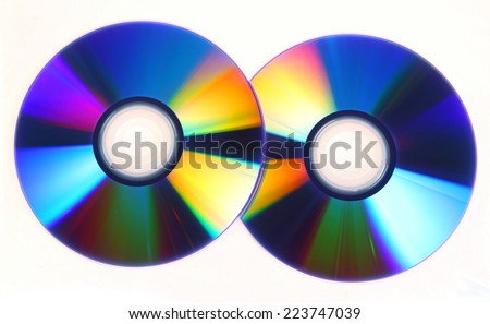 CD or DVD with lots of vivid colors reflected on its surface - stock photo