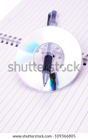 CD-ROM and book - stock photo