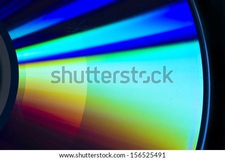 cd-rom rainbow reflection with black background - stock photo