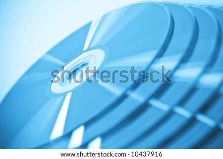 CDs in stack. Useful as a background. Very narrow focus - stock photo