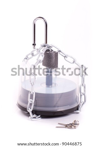 CDs in the box linked chain and padlock isolated - stock photo