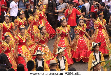 CEBU CITY, PHILIPPINES - JAN 15: Filipino Catholic devotees dance and perform in the Annual Feast of the Child jesus or Sinulog Santo Nino Parade  in Cebu City, Philippines on Sun, Jan 15, 2012. - stock photo