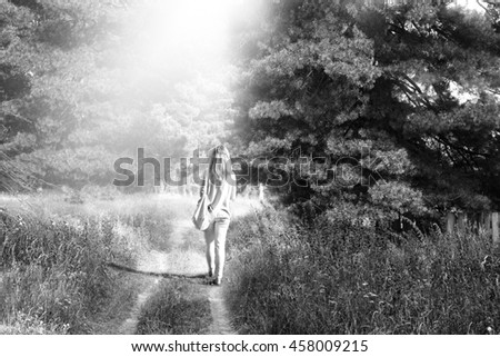 Cedar forest background, old rare trees. Woman walks on a footpath - stock photo