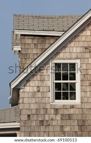 Cedar House with cedar shakes turning silver and gray - stock photo
