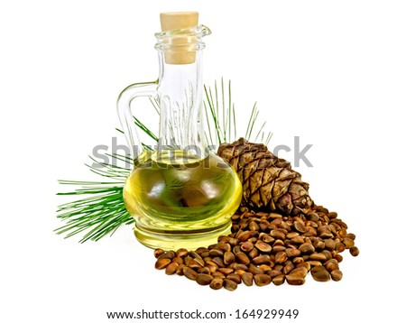 Cedar oil in a glass bottle, a sprig of cedar with cedar cones, cedar nuts isolated on white background - stock photo