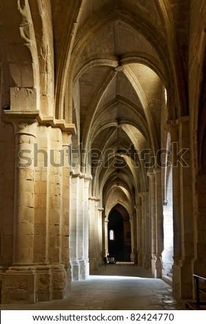 Ceiling and columns, cloister of Monastery of Santa Maria de Poblet, Tarragona Province, Spain - stock photo
