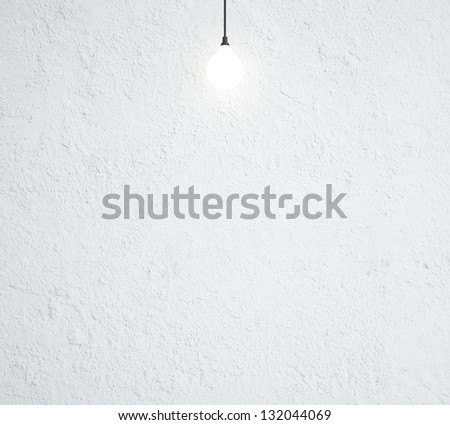 ceiling lamp and concrete wall - stock photo