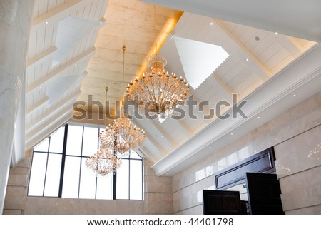 Ceiling of big hall with lamp - stock photo