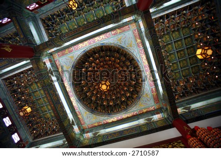 Ceiling of Chinese temple with Chinese decorations. - stock photo