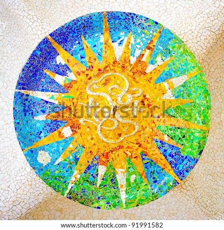 Ceiling with a sun mosaic at the Parc Guell designed by Antoni Gaudi, Barcelona, Spain. - stock photo
