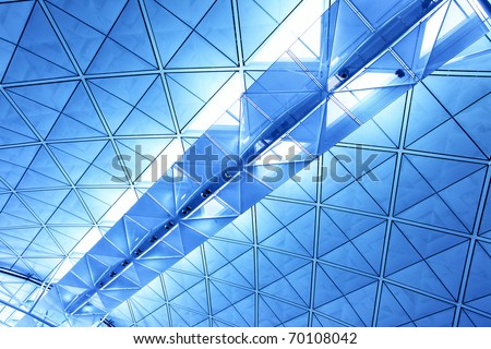 Ceiling with skylight toned in blue color - stock photo