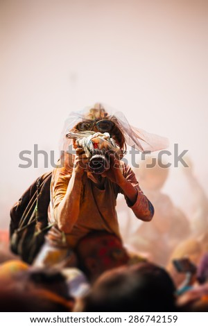 Celebrants dancing during the color Holi Festival - stock photo
