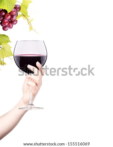celebrate the holiday background - hand with red splashing wine making toast