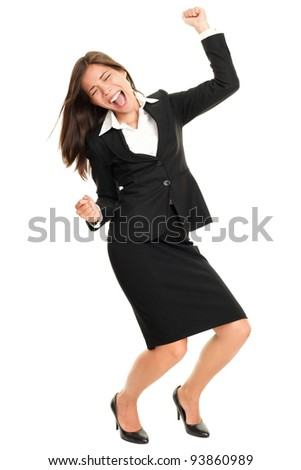 Celebrating business woman dancing happy joyful cheering in suit isolated on white background in full body. Ecstatic and excited beautiful multiracial Caucasian / Chinese Asian young business woman - stock photo