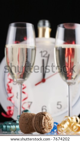 celebrating New Year, Champagne glasses, clock and confetti