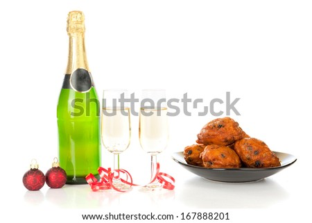 Celebrating new year with champagne and Oliebollen! - stock photo