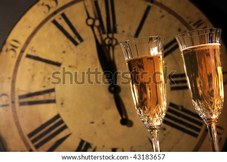 Celebrating New Years with glasses of champagne - stock photo