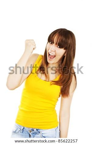 Celebrating success. Young successful woman in joyful celebration. - stock photo