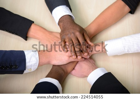 Celebrating victory. Group of business people joining hands. - stock photo