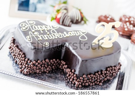 Celebrating wedding anniversary heart shape chocolate stock photo