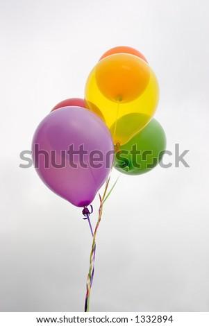 Celebrating with balloons - stock photo