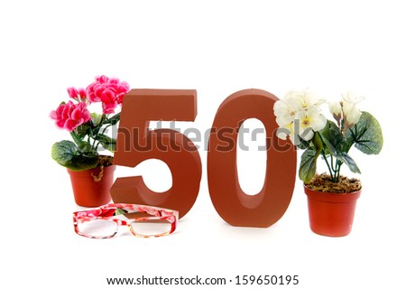 Celebrating your Fiftieth birthday, getting presents like reading glasses and a begonia - stock photo
