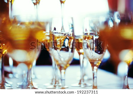 Celebration. Abstract picture of champagne glasses. Gently toned, vintage colors, selective focus. - stock photo