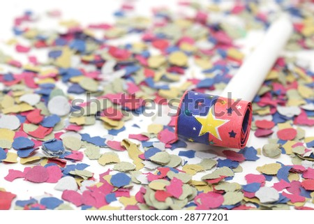 celebration and party one blowers on paper confetti - stock photo
