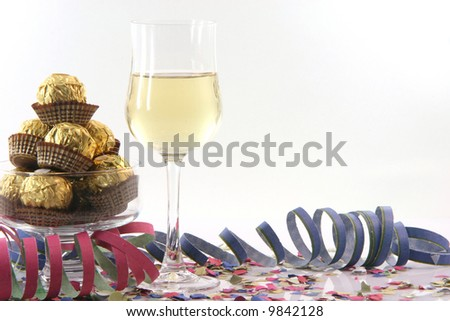 celebration and party time with copy space paper confetti streamers wine glass and snacks isolated on white background - stock photo