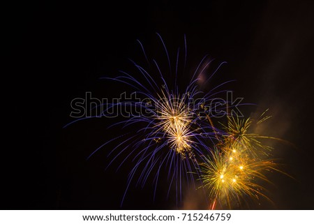 Celebration beautiful colorful fireworks over night sky copy space. Holidays salute. Independence Day. New Year. Yellow amazing fireworks,