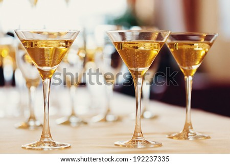 Celebration. Champagne glasses. Gently toned, selective focus. - stock photo