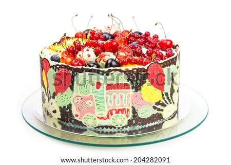 Celebration colorful cake decorated with fruits and chocolate for kids party  - stock photo