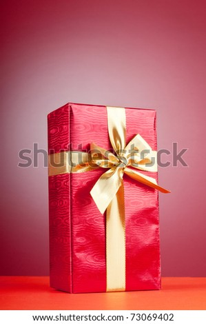 Celebration concept - Gift box against colorful background - stock photo