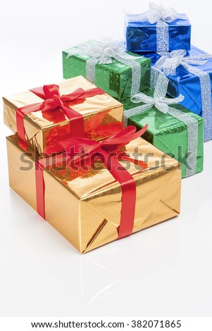 Celebration Concepts. Many Colorful Wrapped Up Gift Boxes Standing In Line Together. Against White. Vertical Image - stock photo