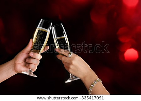 Celebration. Couple holding glasses of champagne making a toast. Space for text. - stock photo