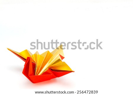 Celebration crane / A traditional japanese paper craftused when congratulating a wedding, new year birthday. - stock photo