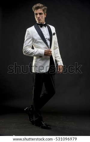 Celebration, Elegant and handsome man dressed in tuxedo for New Year's Eve or party