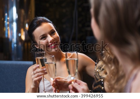 celebration, friends, bachelorette party and holidays concept - happy women with champagne glasses at night club - stock photo
