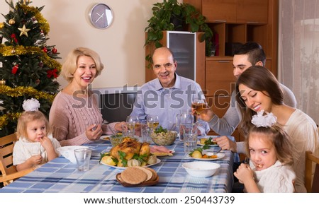 Celebration of christmas in the bosom of family at the table at home  - stock photo