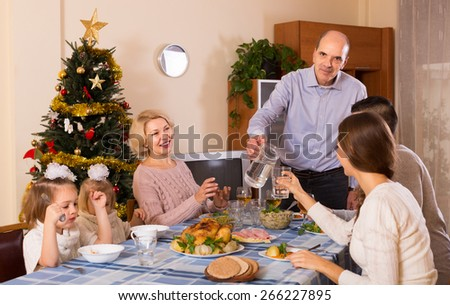 Celebration of christmas in the bosom of happy family at the table at home