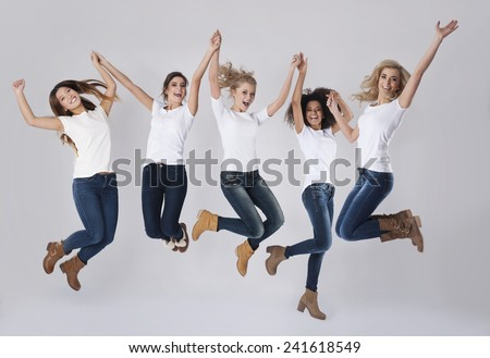 Celebration of success by jumping up - stock photo