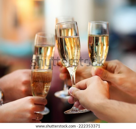 Celebration. People holding glasses of champagne making a toast - stock photo