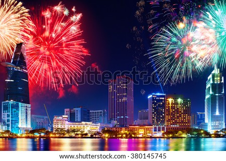 Celebration. Skyline with fireworks light up sky over business district in Ho Chi Minh City ( Saigon ), Vietnam. Beautiful night view cityscape. Holidays, celebrating New Year.  - stock photo