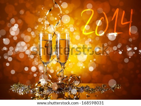 Celebration still life with champagne on orange sparkle blur background